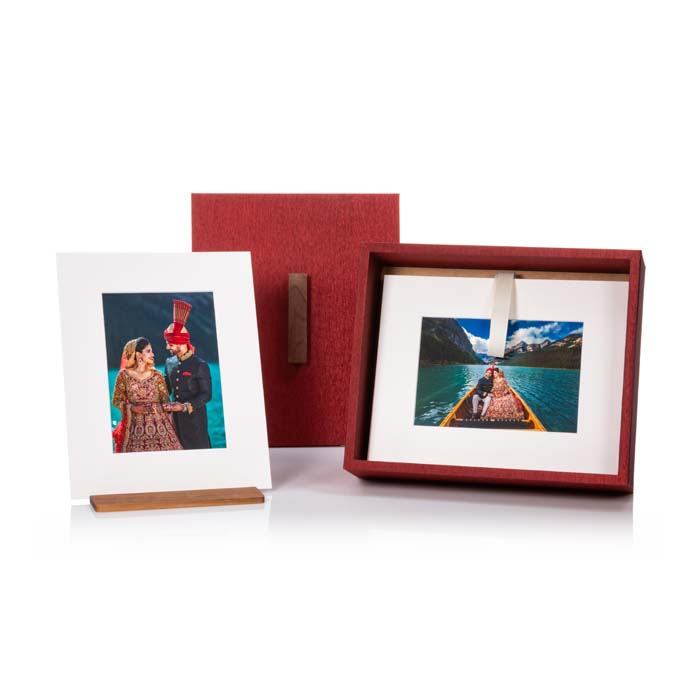 Matted prints in red folio box
