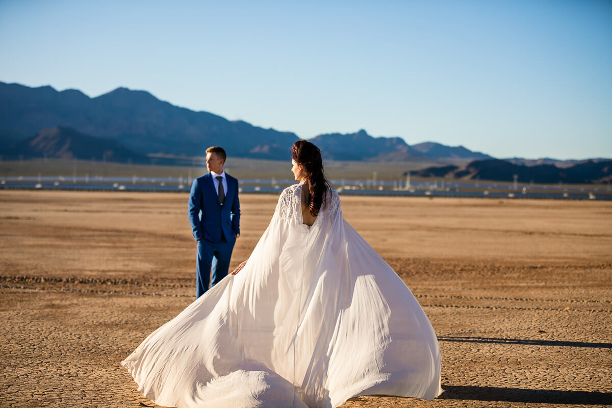 bride and groom desert portraits veil flowing