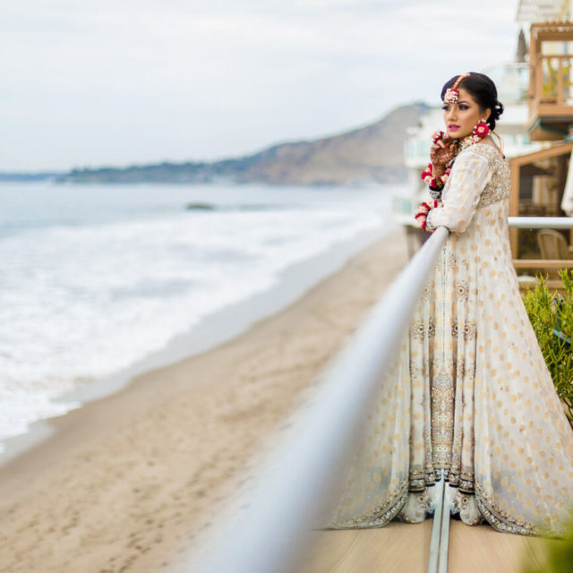 bridal portrait by beach wearing white lengha