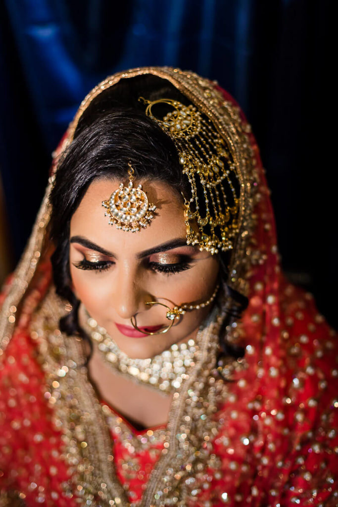 indian bridal portrait during hair and makeup