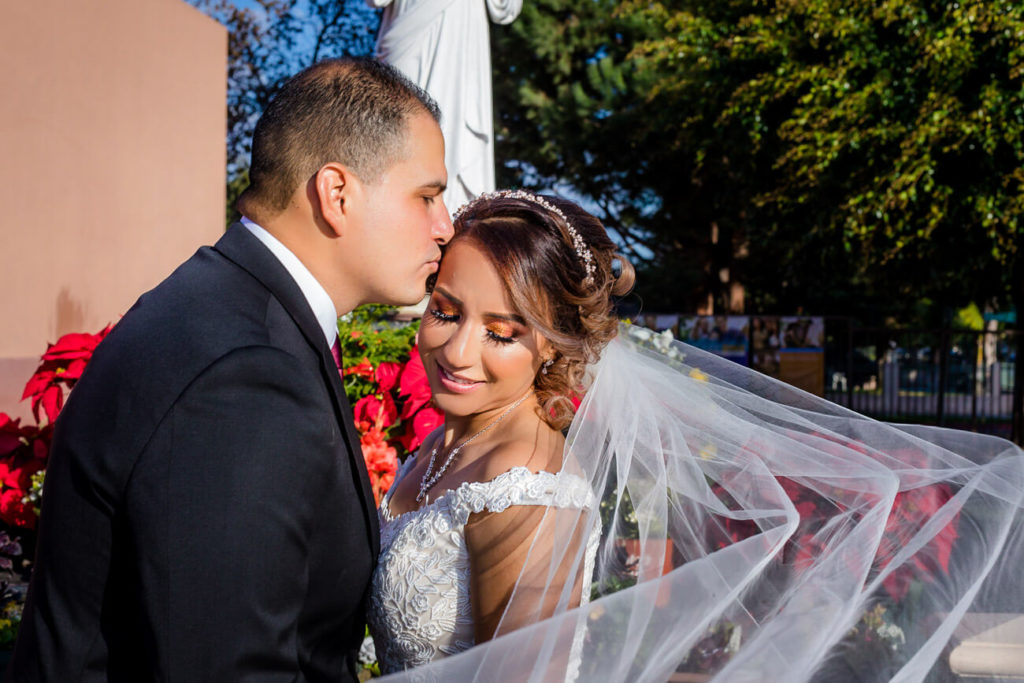 bride and groom veil flowing golden hour sunset portraits