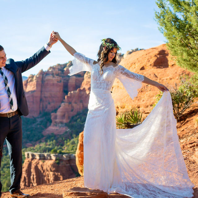 bride and groom portraits dancing in mountains