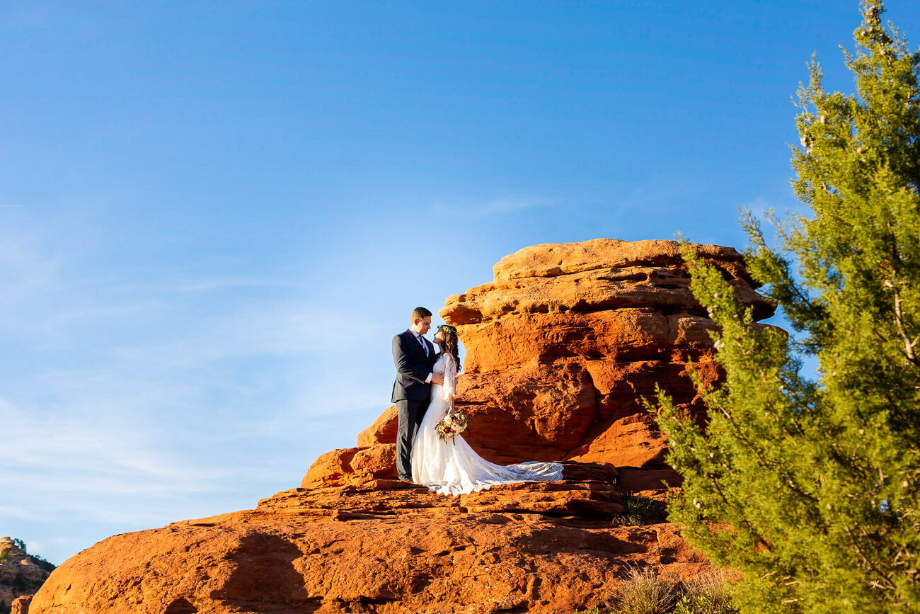 bride and groom portraits in mountain on rocks