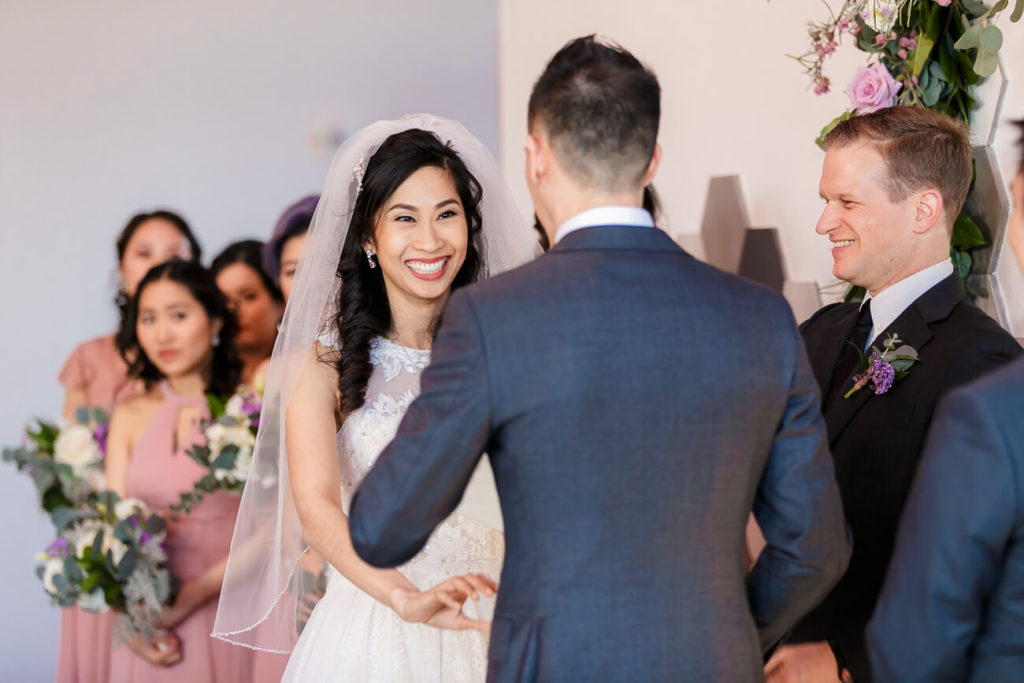 bride laughing during groom's vows