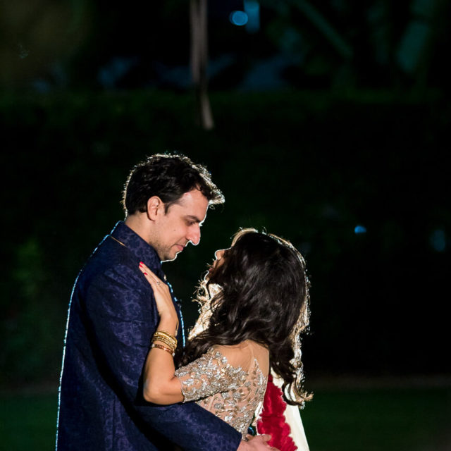 outdoor night portraits for bride and groom by market lights