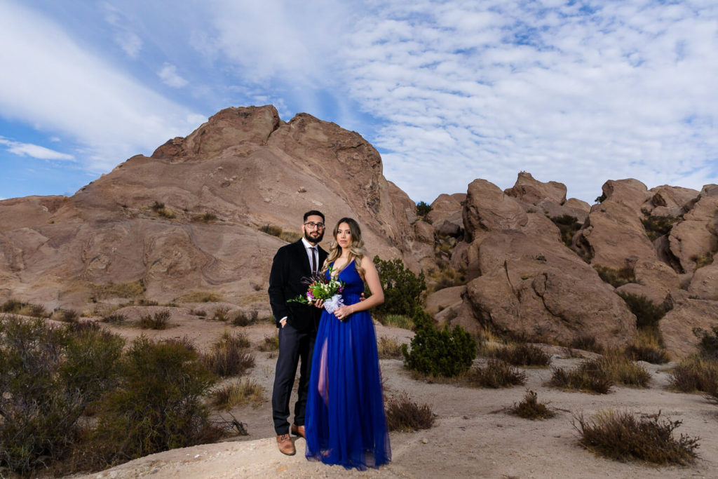 bride and groom portraits in front of rocks